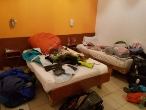 Gear explodes everywhere while we organize in our hostel.